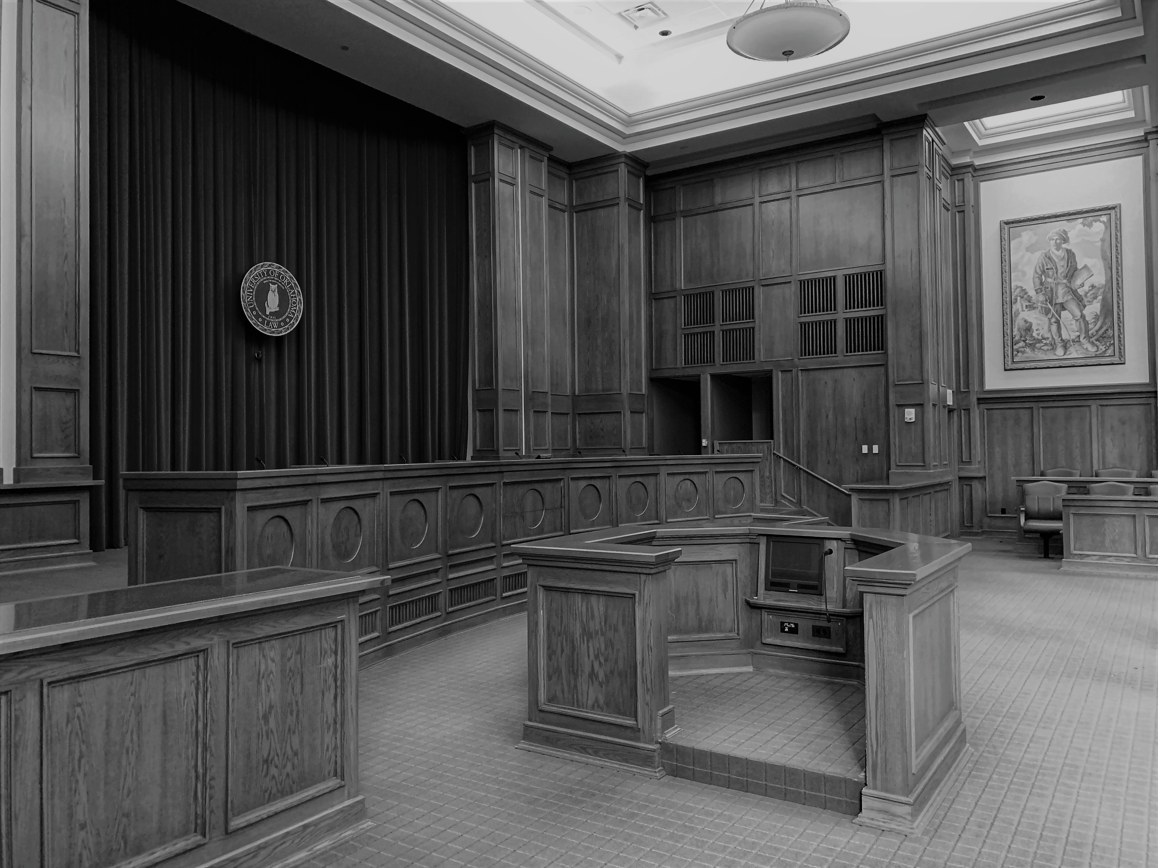 A gray-scale image of a law school courtroom, similar to ones where many Lionbridge legal interpreters studied.