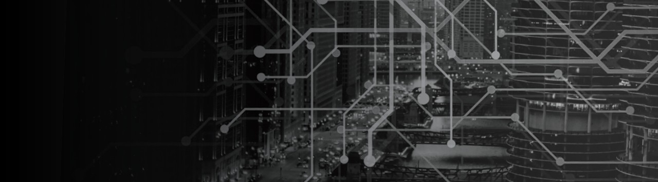 The black and white photo shows a geometric pattern of line segments over the image of a city scene. Skyscrapers create the landscape and car headlights illuminate the dark sky. The photo suggests movement and the need to evaluate a multivendor strategy..